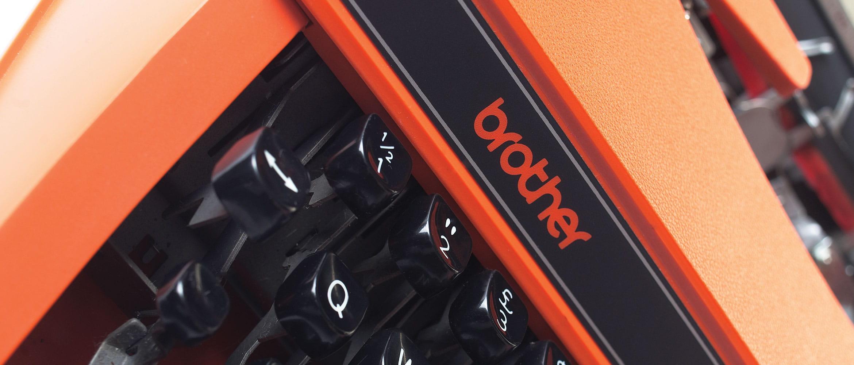 Orange and black Brother typewriter