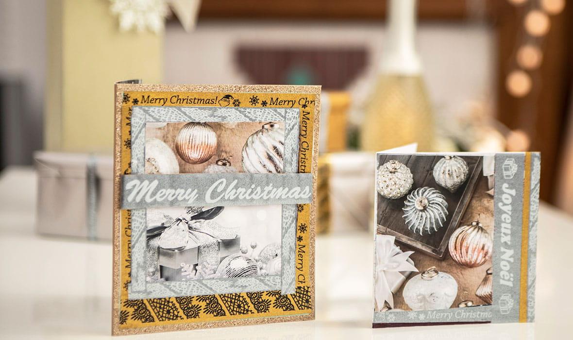 Håndlagde julekort pyntet med glitrende merketape i sølv og gull printet ut på en Brother P-touch CUBE merkemaskin