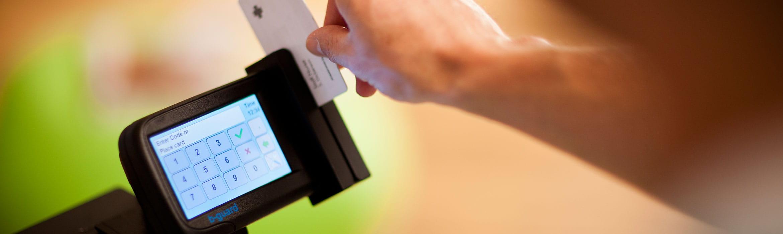 Person swiping ID card