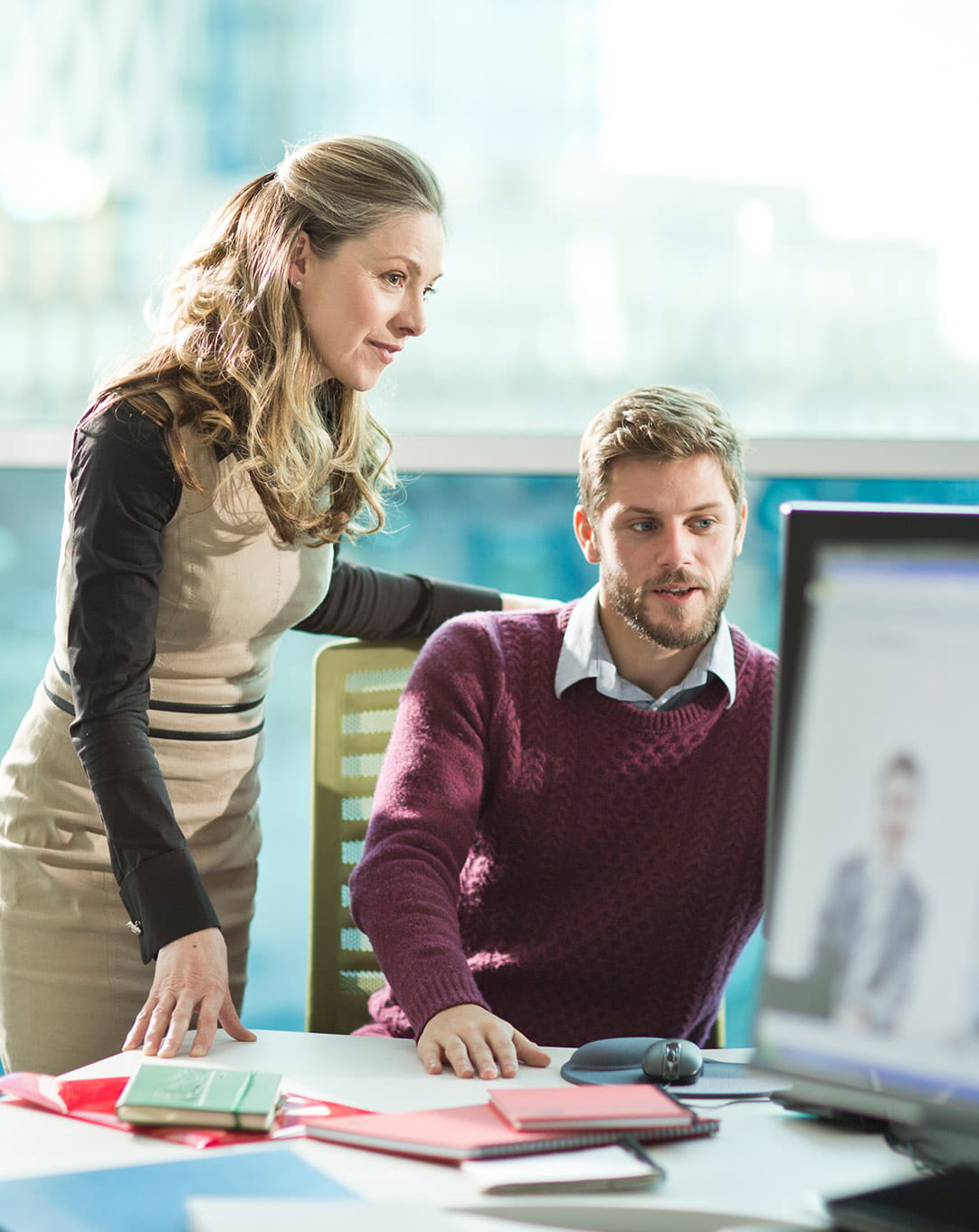 Brother OmniJoin woman observing man's work on computer